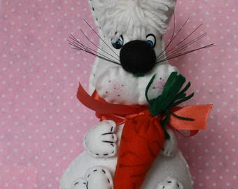 Hand made naughty rabbit and his carrot felt