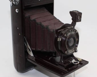 Soho Cadet Bakelite Folding Camera with red/burgundy bellows c.1930 – Working shutter and very good condition - Very rare