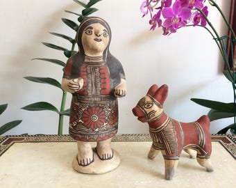 Woman and dog pottery.