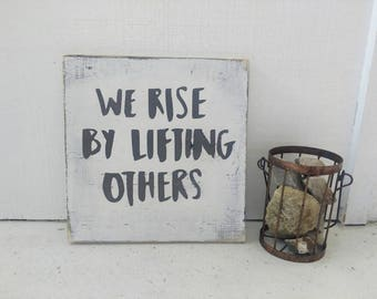 WE RISE by Lifting Others // encouragement // wood sign // rustic decor // distressed // farmhouse decor // inspirational words