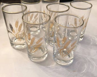 Set of Seven Wheat Juice Glasses with Gold Design