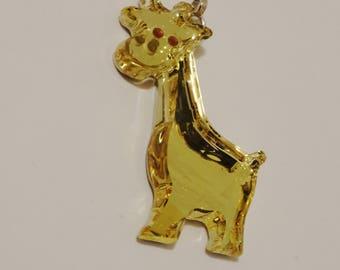 "Swarovski Crystal Signed W/ Swan Logo 1 3/4"" Yellow Giraffe Pendant."