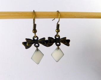 Enameled white and bronze bow earrings