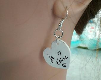 A pair of white heart earrings