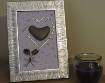 Heart-shaped pebble frame with sparkles and mini roses.
