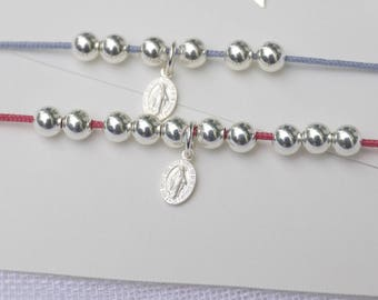 raspberry pink cord bracelet beads and silver miraculous medal