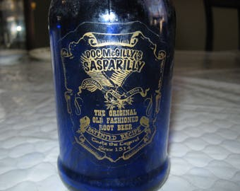 """Doc McGilly Cobalt Blue Sasparilly Root Beer Bottle With Stopper 9 1/2"""""""