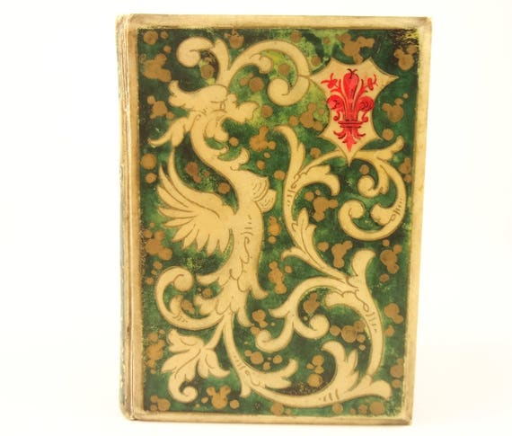 1863 Romola by George Eliot. Painted vellum binding by Italian fine binder Alfonso Dori. 16 tipped-in albumen photographs of Florence.