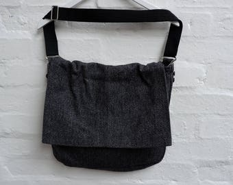 Over-the-shoulder messenger bag. Made from a recycled mans suit jacket. Lovely dark grey colour, tweedy feel.