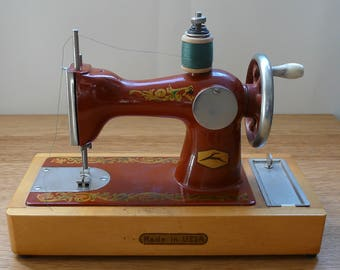 Super Cute and working sewing machine toy USSR