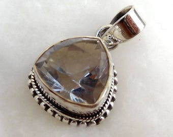 A beautiful crystal  quartz pendant sterling silver 925 .