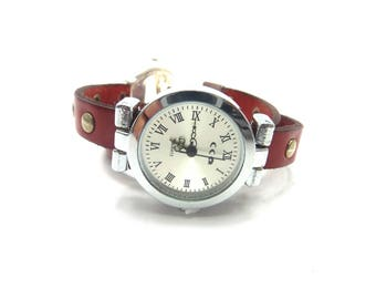 Shown in double wrist silver studded red leather and its toggle clasp