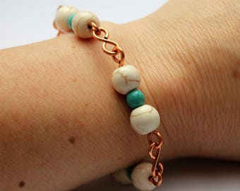 Copper bracelet with infinity links and white turquoise and blue turquoise beads, with spiral clasp