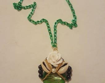 Cowrie shell and rose pendant necklace