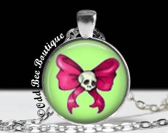 """Skull Bow Old School/New School Tattoo Art Necklace. Pink Bow on Green.  Punk, Gothic, Rockabilly Jewelry. 1"""" Silver & Glass Pendant"""