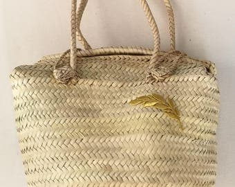 Square bag of natural Palm with Golden Spike.