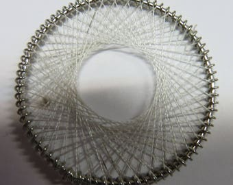 White woven wire metal disc