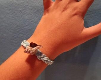 Light blue bracelet with real murix seashell