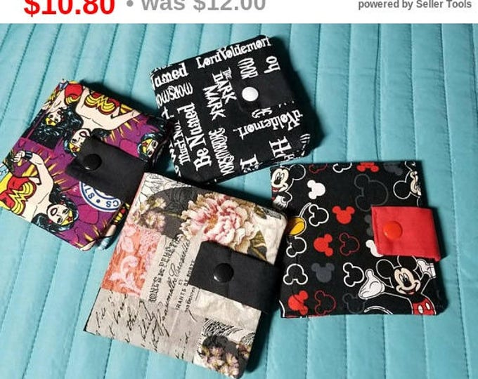 Strap closure fabric wallets