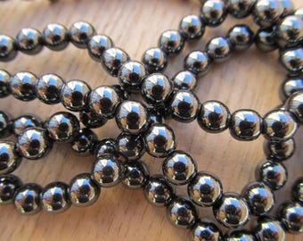 Set of 25 6 mm silver color hematite round beads.