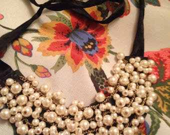 Choker style black ribbon with tons and tons of faux pearls