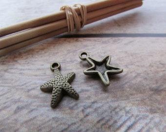 10 Breloque étoile de mer  en métal bronze  - 16 x 12 mm - trou 1.5 mm - 546.22