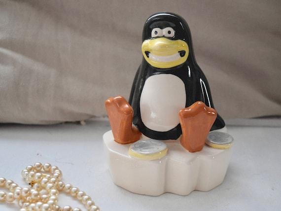 Grinning Penguin on iceberg, Aardman Creations Savings Bank, Money Box, Piggy Bank, Ceramic, quirky birthday, housewarming gift