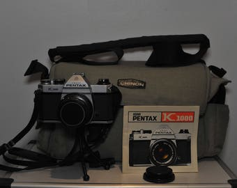 Asahi Pentax K1000 35mm SLR Film Camera with SMC Pentax-M 50mm F1.7 Prime Lens in a Chinon padded shoulder bag