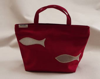a small red bag with two sardines beige and ecru