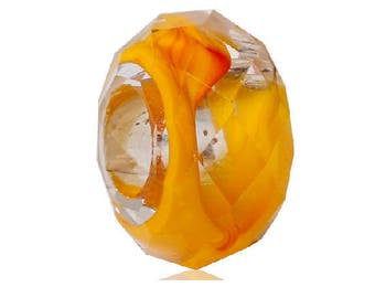 A transparent yellow orange 14 mm x 8 mm faceted bead