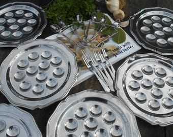Complete 'Guy Degrenne' French Escargot/ Snail Serving Set. Set of Six Stainless Steel Plates, Forks and Tongs.