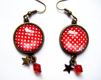 Red earrings with white polka dots under glass cabochons