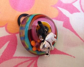 Ring spun Lampwork Glass Bead.