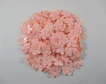 Sequin sewing, flower, light pink color.