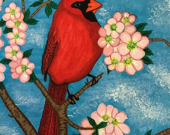 Male cardinal in a blossomed apple tree