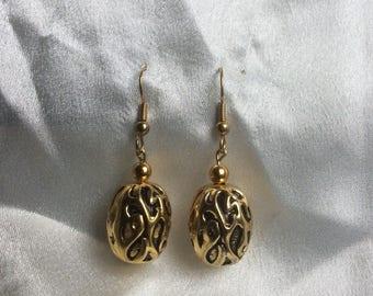Fancy gold earrings
