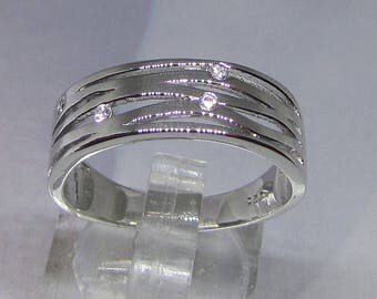 Silver ring and 4 round Zirconium Oxide size 54