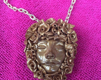 Golden goddess pendant