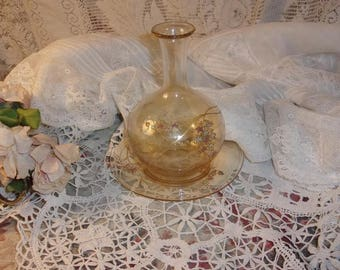 A charming old a little amber glass bedside carafe