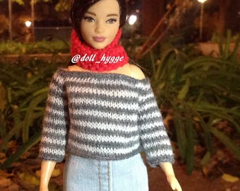 Hand knitted striped sweater for a curvy barbie doll