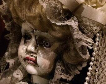 Broken face doll