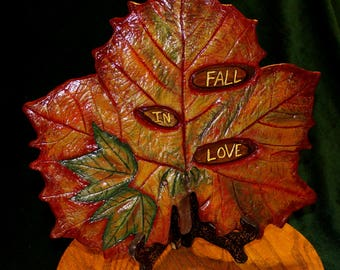 Leaf Casting of a Large Sycamore Leaf & Maple leaves.  Handpainted in Fall Colors, with wooden inlays that say, Fall In Love.