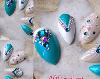 Nail art stilettos turquoise and white, rhinestone crystal