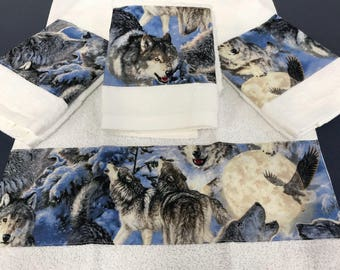 Set of Four Quality Hand Towels Embellished with Wolves and Snowy Scene