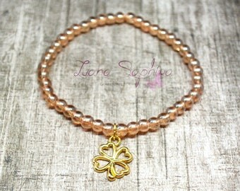 Pearl bracelet gold/Brown with Golden clover