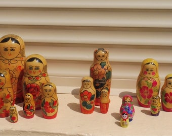 A Delightful Collection of Five Sets of Russian Nesting Dolls.