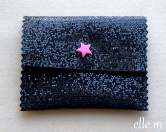 Pink pouch made of fabric with black sequin and star snaps