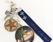 Cadeau vacance porte-clés bijou de sac, face a la mer, plage, mer,palmier,étoile de mer.Ref.Sup.5