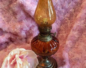 "Vintage 9.5"" amber glass oil lamp"