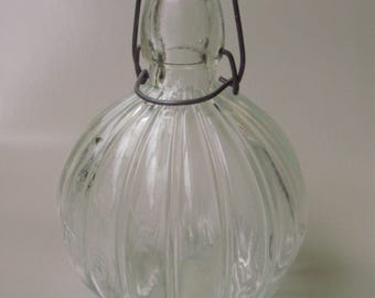 ANTIQUE,Large RIBBED BOTTLE/glass ,buckled glass